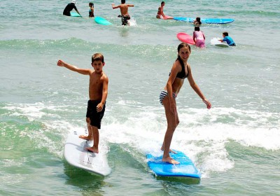 Surf camp classes are divided by ages and skill levels